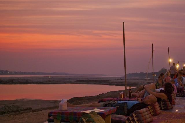 people enjoying the vientiane sunset