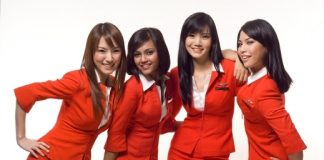 four air asia stewardesses in red uniform