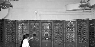 A man in front of the oldest computer in the world
