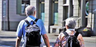 Senior travelers walking hand in hand