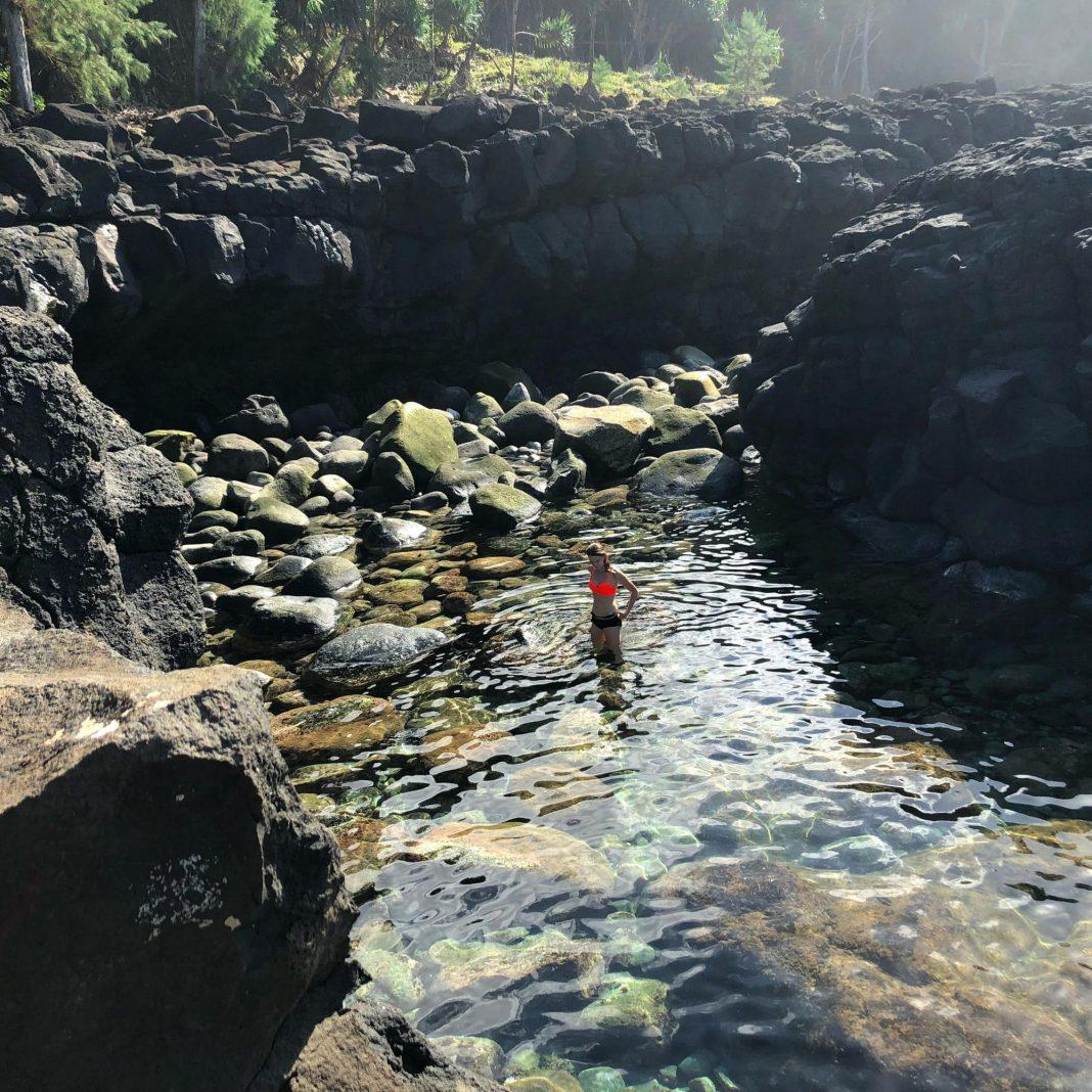 girl on stream water of kauai queens bath