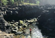 girl on stream water of kauai queens bath