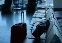 Luggage at airport seating area