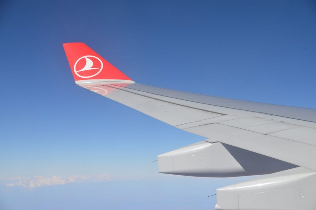 Turkish Airlines logo on the wing of a plane
