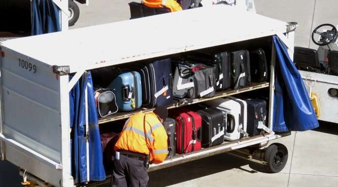 Workers preparing Airport baggage