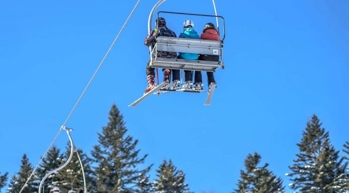 Family trip to ski resort in cable car