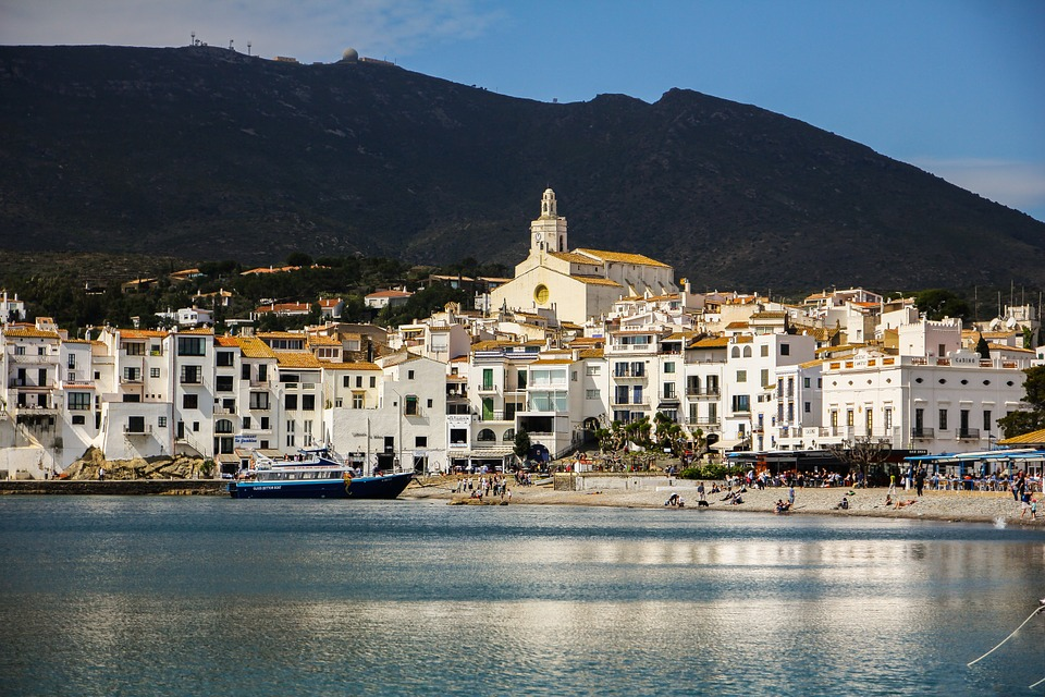 A Beach and the White Town of Cadaques