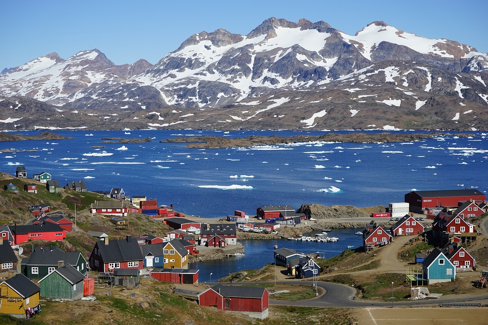 Town in East Greenland set Against Mountains