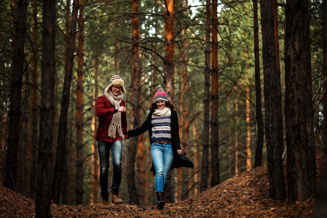 A young couple enjoying a walk in the woods