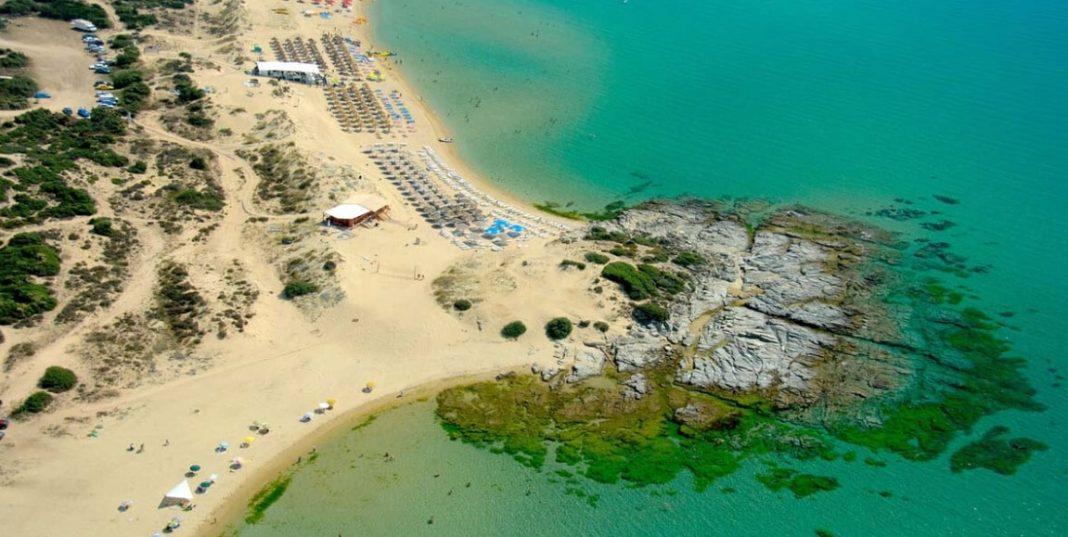 Emerald sea at Ammolofoi beach in Kavala