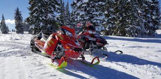Two snowmobiles on mountain in Colorado