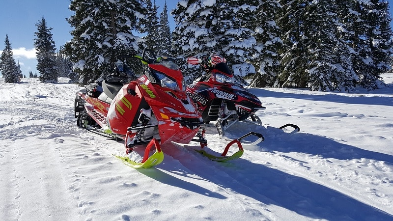 Two snowmobiles on mountain in Colorado