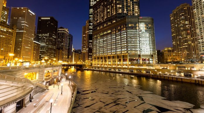 The frozen lake and lit buildings on a cold night in Chicago
